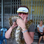 Helen with cuddly snake in Thailand